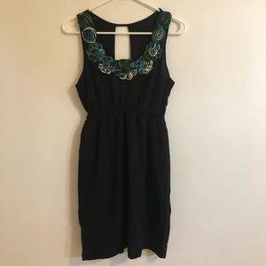 Sleeveless Black Dress with Rosettes and Open Back